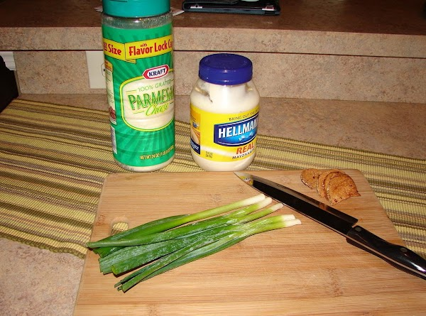 While the bread is toasting.  Combine the Parmesan, mayonnaise and scallion tops.