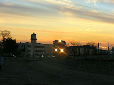 Train in front of Bona Allen Tannery at Sunset
