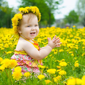 Happy little girl  on the meadow with yellow flowers by Ira Ivanova - Babies & Children Toddlers ( person, lawn, bright, blond, little, yellow, people, kid, caucasian, nature, childhood, smile, cheerful, flower, eye, grass, white, fun, sunlight, portrait, day, outside, plant, face, fashion, tress, joy, one, beauty, cute, landscape, spring, sun, child, girl, happy, baby, hair, offspring, park, green, beautiful, human, kids in the summer, field, spring colorful flowers, dandelion, blue, outdoor, background, meadow, summer )