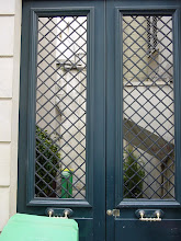 Photo: Behind the latticework doors at 10 Rue Thouin, is a painted section of the Wall.