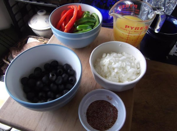 Chop onion, slice peppers.  Squeeze fresh lime juice (approx. 1/3 cup).