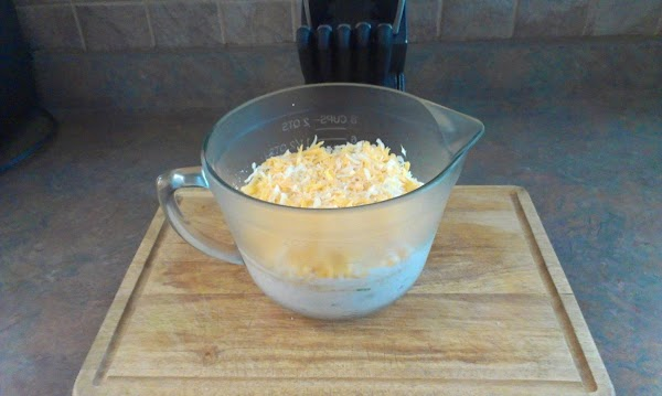 Mix together in a large glass bowl Cheeses, Mayo, Sour cream, Green onion, Garlic,...