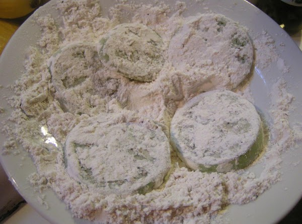Slice green tomatoes and coat both sides with flour mixture.  Turn over in...