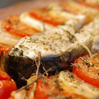 Carp Steak With Roasted Tomatoes And Onions