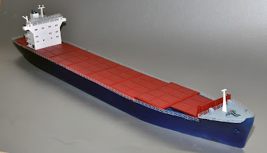 Photo: This is the production version of a 550 TEU Second Generation Container ship, still with the swept bow that was later abandoned on 3 Gen. The full width hatches fold back from the middle to the sides. Price is $775 with details shown.