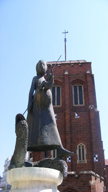 Statue in front of Anglican Church in Bucharest