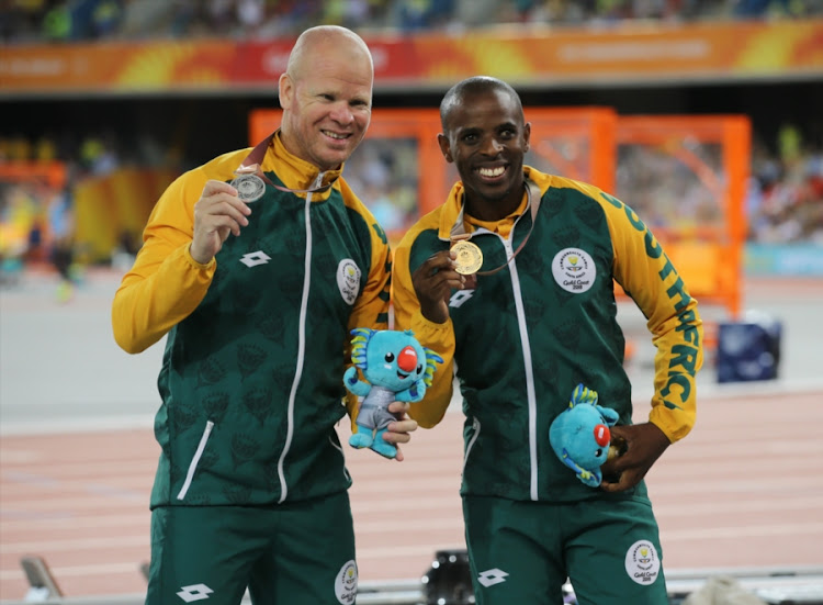 Hilton Langenhoven and Ndodomzi Jonathan Ntutu of South Africa with their medals for the mens T12 100m during the evening session of athletics on day 8 of the Commonwealth Games at the Carrara Stadium on April 12, 2018 in Gold Coast, Australia.