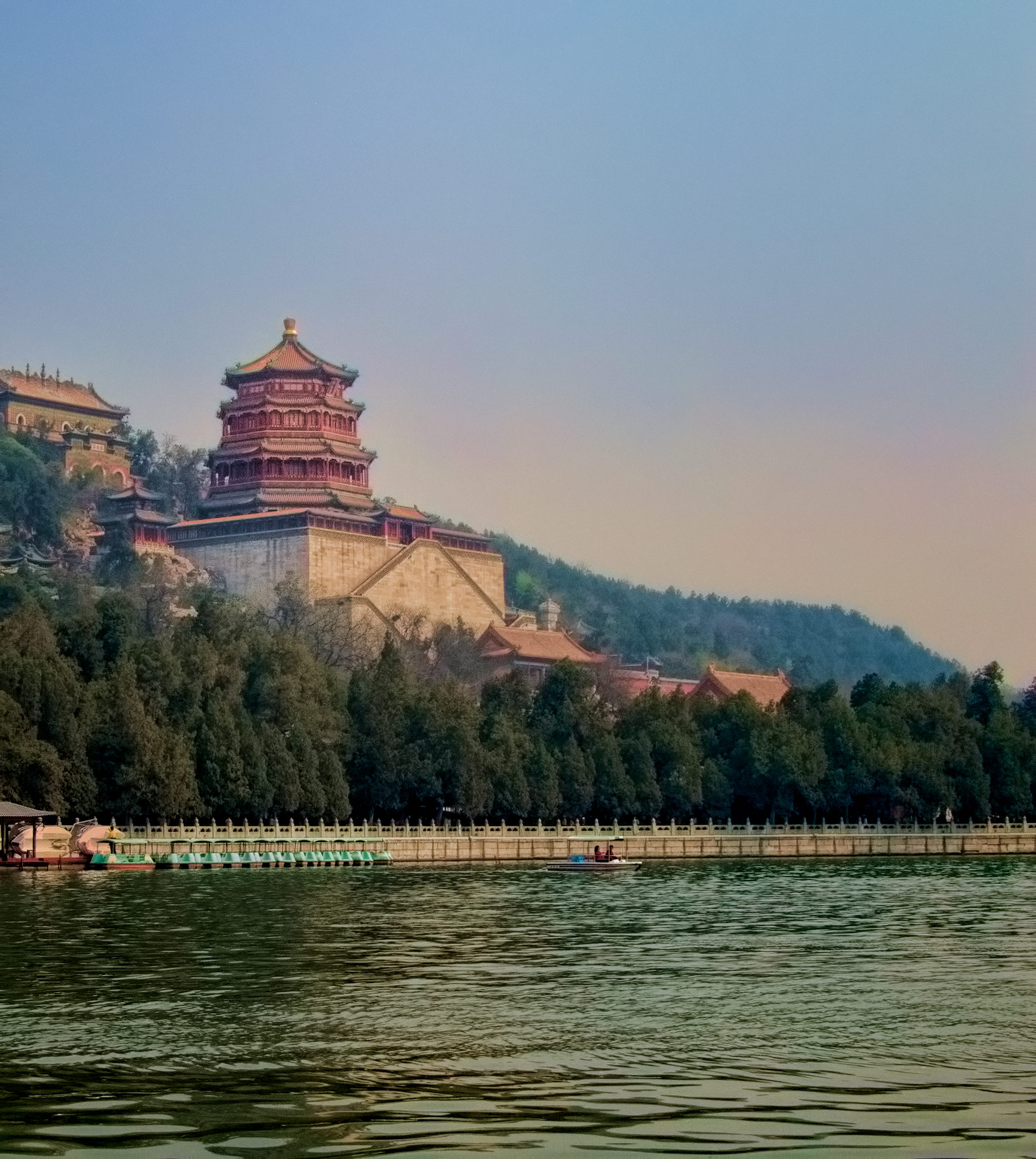 Photo: The Castle The Summer Palace, Beijing - April 2009  On our first day in Beijing we were taken by bus to the Imperial Summer Palace. This is a quite large complex, bigger- I think- than the Forbidden City. It is situated beside a lake, and the surroundings are quite beautiful.  One interesting thing about this place: the lake is man-made- and the mountain upon which the castle sits was created from the soil and rocks that were dug out of the ground to create the lake. Now that's a landscape project!  There's another version of this photo in the China album, but I decided to take another run at it, since both Photoshop(CC) and its plugins are much improved in helpful technology since I did the previous one.  There were problems with the original raw file stemming primarily from the tiny sensor in the camera. That, and my marginal skills. D'Oh! Good thing I know a bit about #PhotoshopCC !  Used in this production were #TopazDenoise3 , #Nik  #Viveza , and #TopazAdjust5 .