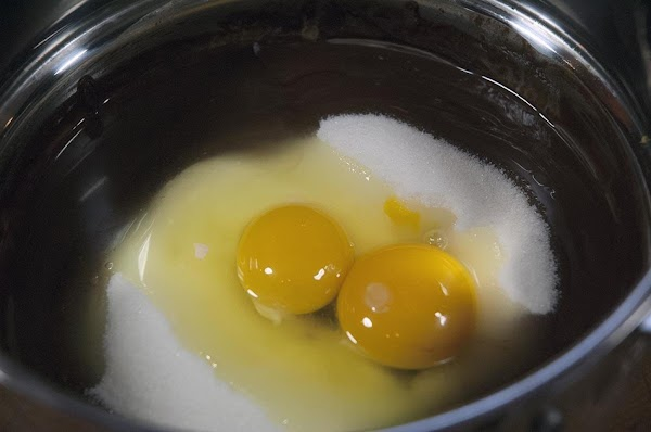 Remove from the heat, and then add the sugar, and eggs.