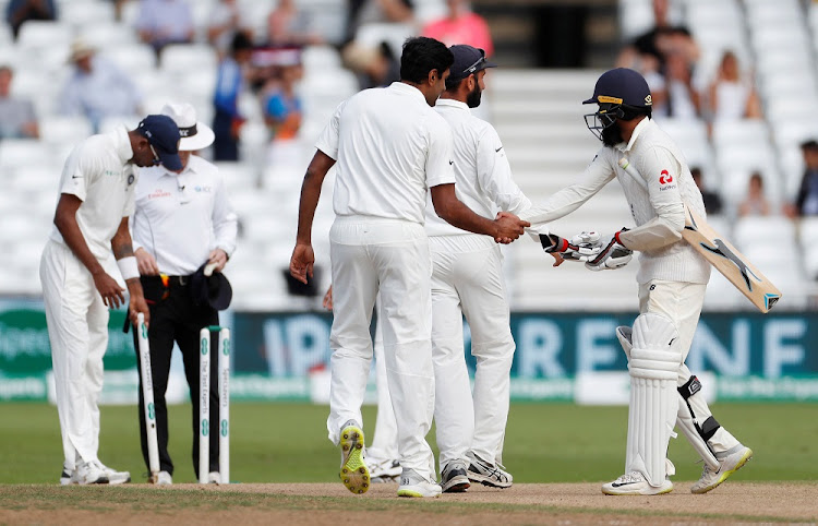 England's Adil Rashid shakes hands with India players after India win the third test at Trent Bridge in Nottingham, Britain, on August 22 2018. Picture: REUTERS/PAUL CHILDS