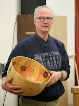 Photo: Our demonstrator for the evening, Mark Supik, likes to make end-grain bowls. He begins by showing a collection of end-grain bowls he has made. He had a large pine tree come down and made the most of it by giving out pieces for people to turn. He made some pretty nice pieces from it himself.
