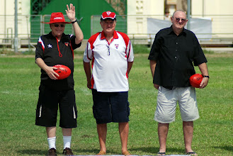 """Photo: Vietnam Football League players and Veterans: Stan Middleton, Ron Vernon and Dick """"Johno"""" Johnston. Match balls supplied by the AFL and Sherrin. Photo, Richard Quinn."""