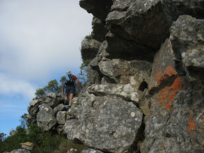 Photo: A long traverse left through trees and over boulders