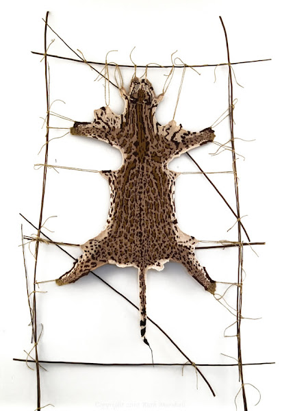 "Photo: #6 Ocelot  2010   46"" x 26""  (116cm x 66cm) Hand knitted textile. Interpretation of ocelot based on study of actual pelt at American Museum of Natural History. Female - New York Zoo, 1897. Yarn, string, sticks. (C) Ruth Marshall, 2011."