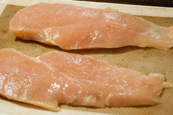 Lay the chicken on a Slipat or parchment-lined baking sheet.