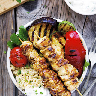 Chicken Souvlaki Grilled Veggie and Quinoa Bowls with Tzatziki-Feta Sauce.