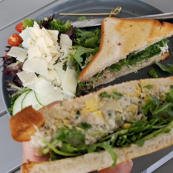 Chicken and artichoke salad with arugula on gluten free bread.