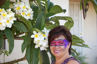 Photo: Masquerade mask by Bella the Clown painted in Fontana, Ca. Call to book Bella today at 888-750-7024