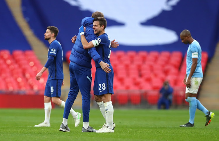 Cesar Azpilicueta of Chelsea celebrates with Thomas Tuchel after the Semi Final of the Emirates FA Cup match between Manchester City and Chelsea FC at Wembley Stadium on April 17, 2021 in London, England.