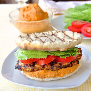 Moroccan Marinated Grilled Chicken Flatbread Burgers with Red Pepper Hummus.