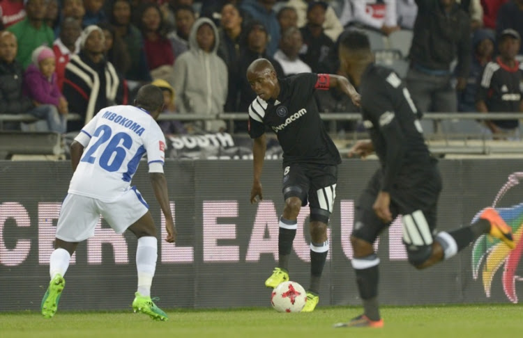 Thabo Matlaba of Orlando Pirates marked by Zephania Mbokoma Chippa United during the Absa Premiership match between Orlando Pirates and Chippa United at Orlando Stadium on August 19, 2017 in Johannesburg.