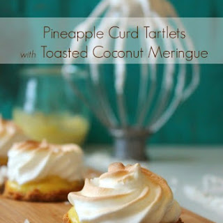 Pineapple Curd Tartlets with Toasted Coconut Meringue.