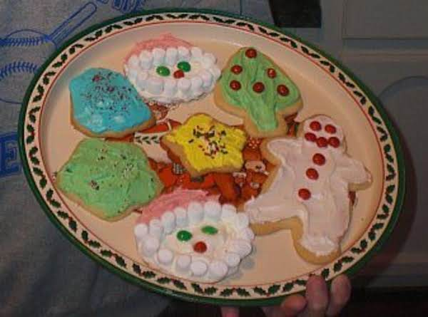 Baking Christmas Cookies Is A Sweet Family Tradition!  The Santa Cookies Are One Of Our Favorites!