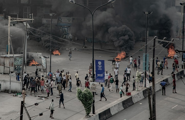 People are seen near burning tires on the street, in Lagos, Nigeria October 21, 2020.