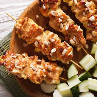 Chicken Satay with Peanut Sauce on Skewers.