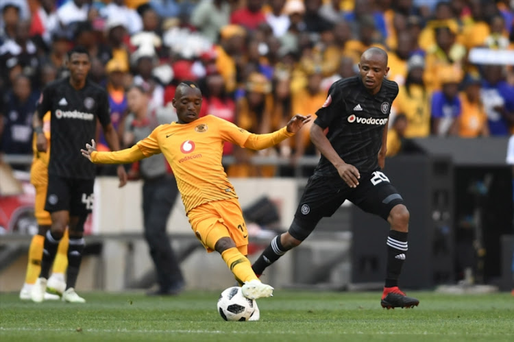 Khama Billiat of Kaizer Chiefs and Xola Mlambo of Orlando Pirates during the Absa Premiership match between Orlando Pirates and Kaizer Chiefs at FNB Stadium on October 27, 2018 in Johannesburg, South Africa.