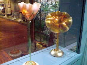 Photo: Vases by Louis Comfort Tiffany (American, New York City, 1848–1933), ca. 1900–1915. Favrile glass.  Right: http://www.metmuseum.org/Collections/search-the-collections/10016764  Left: http://www.metmuseum.org/Collections/search-the-collections/10009757