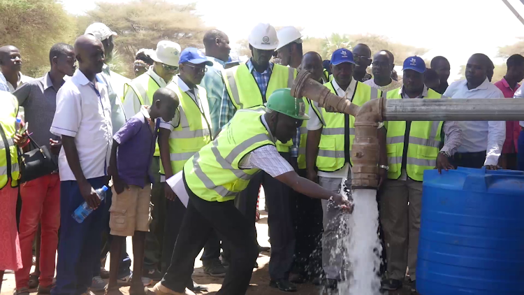 Turkana Governor Josphat Nanok, former Kajiado Governor David Nkedianye and other officials during the launch of the Napuu water project.