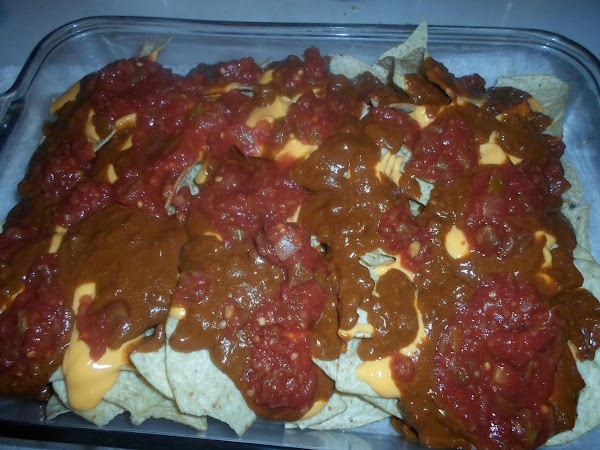 Place the 1 cup of salsa (more if desired) on top of the chili,...