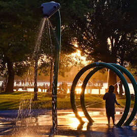Fun In The Park by Garry Dosa - City,  Street & Park  Fountains ( outdoors, sunset, silhouette, playground, summer, park, child,  )