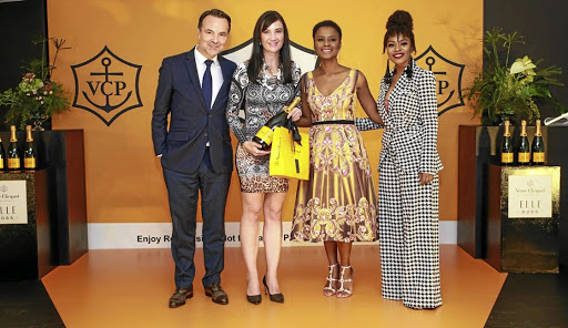 Veuve Clicquot director Thomas Bouleuc, Veuve Clicquot ELLE Boss winner Dr Judey Pretorius, Ndalo Media CEO Khanyi Dhlomo and MC Nomzamo Mbatha.
