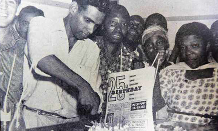 Ebrahim Ismail Ebrahim cuts a cake to celebrate the 25th birthday of the New Age newspaper in Durban in 1962. He is pictured with ANC comrades, including Ronnie Kasrils, on the left.