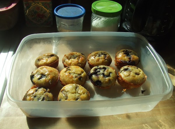 mix wet and dry ingredients together,fold in Blueberries.. drop into muffin pan till3/4 full....