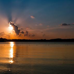 Sunset at Bedok Reservoir by Joydeep Sen Chaudhuri - Landscapes Sunsets & Sunrises ( sunset, cloud formation, bedok reservoir, sunrise, landscapes, rays, singapore, sun )