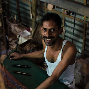 A Smile of Industry by Rahat Amin - People Portraits of Men ( handloom, low light, industry, nikon, working, d5100 )