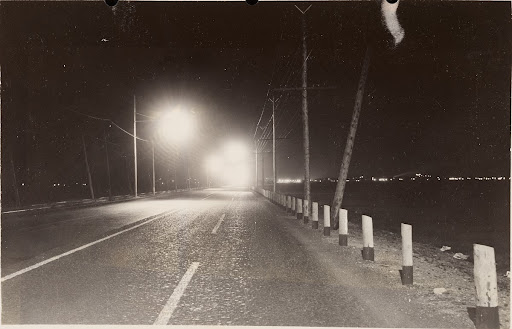 Salem turnpike lighted with 4000-lumen lamps in form 47 Eternalite 250 ft. linear spacing, staggered, 25 ft. mounting height. 9-14 ft. telescopic brackets. Units alternately 8 and 12 ft. from center line of roadway. 8.5-in. Hi-way rippled bowl refractor. Night view looking toward Lynn, Mass.