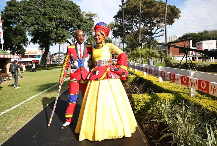 Musa And Lindo Mathebula wearing her own design at the Vodacom Durban July.