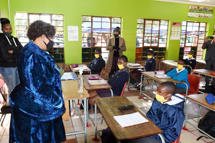 Basic Education minister Angie Motshekga speaks to Grade 7 pupils during a visit to Funukukhanya Primary School at Tsakani in Ekhuruleni, Gauteng, to monitor reopening of schools to ensure compliance. Picture: FREDDY MAVUNDA
