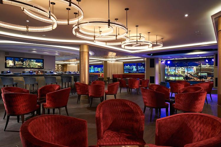 Enjoy entertainment and signature cocktails alongside Norwegian Escape's casino at the Skyline Bar.