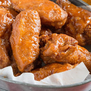 John's Fried Chicken Wings with Spicy Honey Butter.