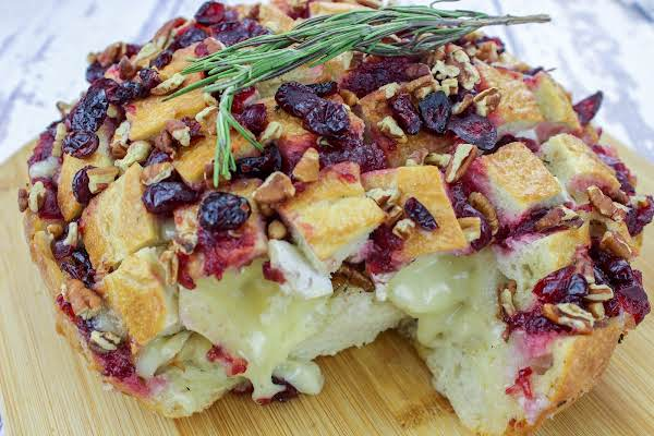 Cranberry Brie Pull-apart Bread With Brie Oozing Out Of The Bread.