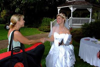 Photo: Harpist Kristine Snyder meets the bride... (http://www.mauiharps.com)