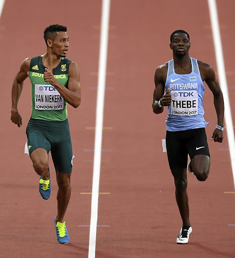 Wayde van Niekerk, left, on the track against Baboloki Thebe. Van Niekerk will take home  R250,000. Picture: SHAUN BOTTERILL/GETTY IMAGES