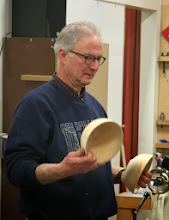 Photo: Mark shows two bowls turned from one log, one end grain and one side grain. He passed them around to show the differences.