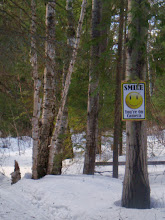 Photo: Both snowmobile entrances greet visitors with a friendly reminder to smile.