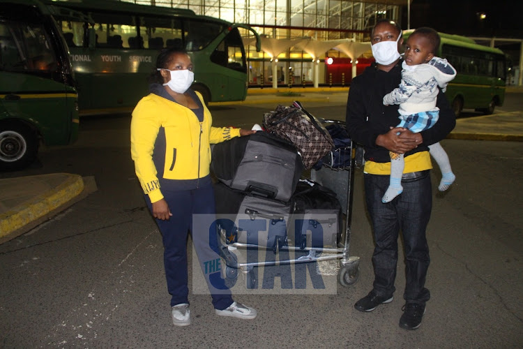 Naomi Maina and her husband David Mwaniki pose for a family photo after landing from Hyderabad, India where they had gone for treatment of their 2-year-old son Jonathan Wise at JKIA, Nairobi on May 7, 2020/ANDREW KASUKU